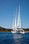 Motor sailing cruise ship M/S Panorama (Variety Cruises) under full sail, Paxos, Ionian Islands, Greece