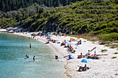 Overhead of people relaxing on beach, Paxos, Ionian Islands, Greece