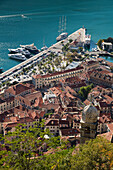 Overhead of Kotor Old Town with motor sailing cruise ship M/S Panorama (Variety Cruises) at pier, Kotor, Montenegro