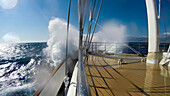 Waves crash across bow of motor sailing cruise ship M/S Panorama (Variety Cruises) during choppy seas, Adriatic Sea, near Albania
