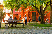Adelhauser Platz and people with motion blur, Freiburg, Black Forest, Baden-Wuerttemberg, Germany
