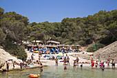 People relax on beach at Cala Portals Vells bay, Portals Vells, Mallorca, Balearic Islands, Spain