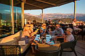 People enjoy cocktails in Sunset Lounge Bar of Jumeirah Port Soller Hotel & Spa, Port Soller, Mallorca, Balearic Islands, Spain