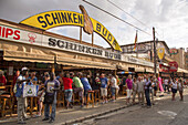 People drink and party at Schinkenbude near Bierkönig bar and beer hall, s'Arenal, near Palma, Mallorca, Balearic Islands, Spain