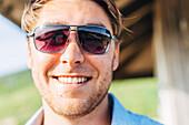 Smiling Caucasian man wearing sunglasses