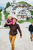Caucasian father carrying daughter, Tarvisio, Vienna, Austria