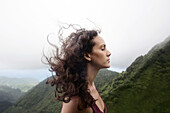 Wind blowing hair of Mixed Race woman
