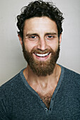 Smiling Caucasian man with beard looking at camera