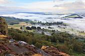 Early morning fog around Curbar village, from Curbar Edge, Peak District National Park, late summer heather, Derbyshire, England, United Kingdom, Europe