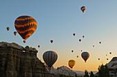 Hot air balloons cruising over Cappadocia, Anatolia, Turkey, Asia Minor, Eurasia