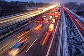 German Autobahn, A 2, winter road, snow, ice, driving, motorway, highway, freeway, speed, speed limit, traffic, night, lights, tail lights, road conditions, infrastructure, Germany