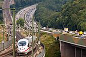 German Autobahn, A3, high speed train, rails, parallel, motorway, freeway, speed, speed limit, traffic, infrastructure, rail and road transport, Neustadt Wied, Germany