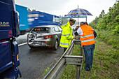 German Autobahn, A 62, police attends accident, rain, insurance, motorway, highway patrol, freeway, emergency, danger, speed, speed limit, traffic, infrastructure, Germany