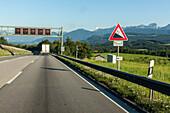 German Autobahn, A 8, farming, green pastures, hills, truck, motorway, highway, freeway, speed, speed limit, traffic, warning sign, gradient, infrastructure, hills, Bavaria, Germany