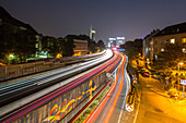 German Autobahn A 40, noise barrier, wall, tail lights light trails, night, pedestrian path, street lights, houses, urban, motorway, highway, freeway, speed, speed limit, traffic, infrastructure, Essen, Germany