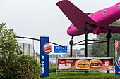 German Autobahn, A 40, fastfood advertising, pink plane, drive-in, motorway, highway, freeway, speed, speed limit, traffic, infrastructure, Bochum, Germany