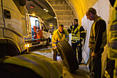 German Autobahn, A 71, firemen inside the tunnel, accident, tyre, truck, repair, emergency, safety, motion, blurred, motorway, freeway, speed, speed limit, traffic, infrastructure, Germany