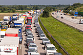 German Autobahn, traffic jam, congestion, A 99, cars, trucks, stopped, halt, motorway, highway, freeway, speed, speed limit, traffic, infrastructure, Germany