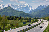 German Autobahn, A 7, Alp panorama, Alps, landscape, farming, green pastures, hills, curve,  motorway, highway, freeway, speed, speed limit, traffic, infrastructure, hills, Bavaria, Germany