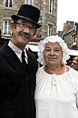 Traditionally dressed couple, in Quintin, La Bretagne en Rose, Bretagne, France