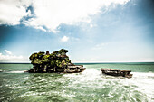Tanah Lot, a temple built on a rock outcropping in the sea, sits off the southwestern coast of Bali, Indonesia