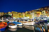 Dusk light on harbour and fishing village of Camogli, Gulf of Paradise, Portofino National Park, Genoa Province, Liguria, Italy, Europe