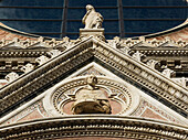 Low angle view of the ornate facade of Siena Cathedral, Siena, Italy