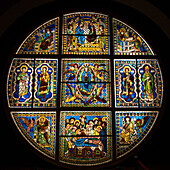 Colourful and ornate circular stained glass window, Siena, Italy