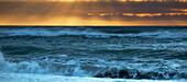 Golden sunset over a west coast sea, Greymouth, South Island, New Zealand