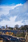 Row housing and a church tower, Bath, Somerset, England