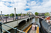 view to the Magere Brug of Amsterdam, Netherlands