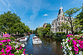 view to canal boats and houses from the Museumsbrug in Amsterdam, Netherlands