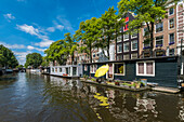 houseboats on a Gracht in Amsterdam, Netherlands