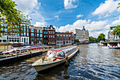tourist boats on the Amstel in Amsterdam, Netherlands