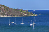 Sailboats near Saint-Florent, in the background the Desert of Agriates, Corsica, Southern France, France, Southern Europe