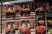 Luxuriant floral decoration at an old timber house, Saas im Praettigau, canton the Grisons, Switzerland