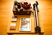 Camera equipment and digital tablet on table