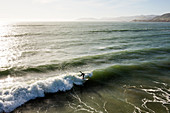 High angle view of surfer in ocean waves