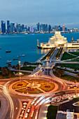 Traffic roundabout near Doha Museum of Islamic Art, Doha, Qatar