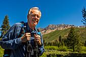 Caucasian man hiking in mountains