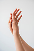 Hispanic woman rubbing hands