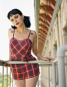 Woman wearing retro dress on balcony