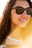 Mixed race woman wearing sunglasses