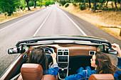 Women driving in convertible