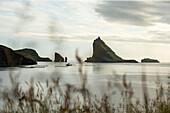 Interesting green cliff formation in the sea, Faeroe Islands