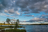 view with the last evening light over a lake near Munkfors, Varmland, Sweden