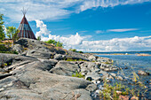 wooden tent standing on the rocks at the waterfront, Oregrund, Uppsala, Sweden