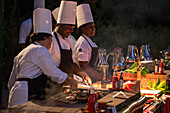 Chefs grill meat during Friday evening Beach BBQ at Sunrise Beach of Half Moon Resort Rose Hall, near Montego Bay, Saint James, Jamaica