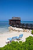 Beach chairs and overwater spa cabana at Half Moon Resort Rose Hall, near Montego Bay, Saint James, Jamaica