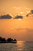 Silhouette of pavillion on jetty Rose Hall, near Montego Bay, Saint James, Jamaica